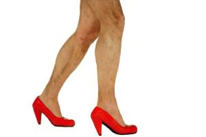 Man in woman shoes on high heel