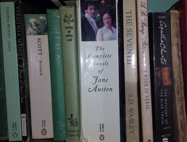 1. Place it next to other wonderful books on your bookshelf! Here it is hanging out with Jane, Thomas, Banjo, and Enid.